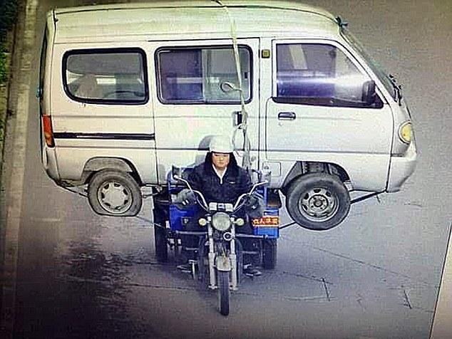 Man Carries Huge Minibus On Back Seat Of Three Wheeled Motorbike