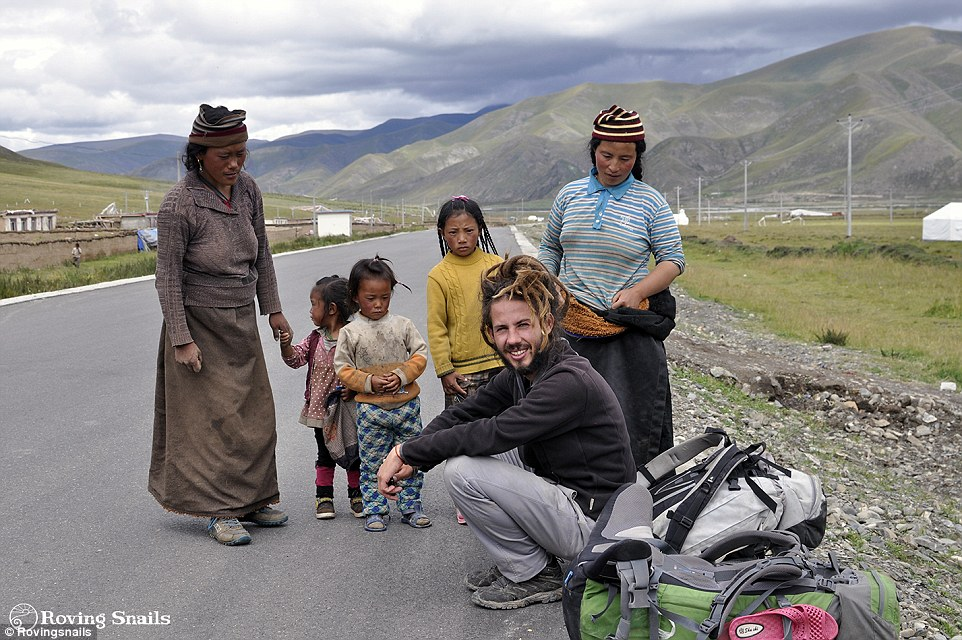 2AB9588500000578-3169253-Boris_on_the_road_in_Tibet_before_the_couple_crossed_Burma_and_a-a-5_1437549131742