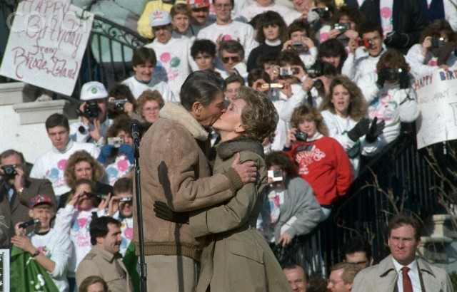 Ronald Reagan and Wife Nancy Kissing