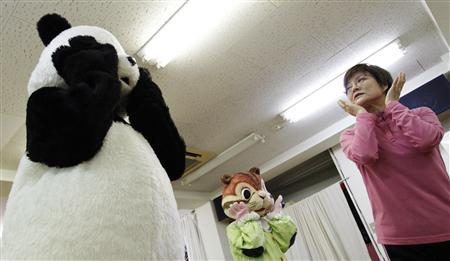 Choko Oohira teaches trainees in character mascots at the Choko Group mascot school in Tokyo