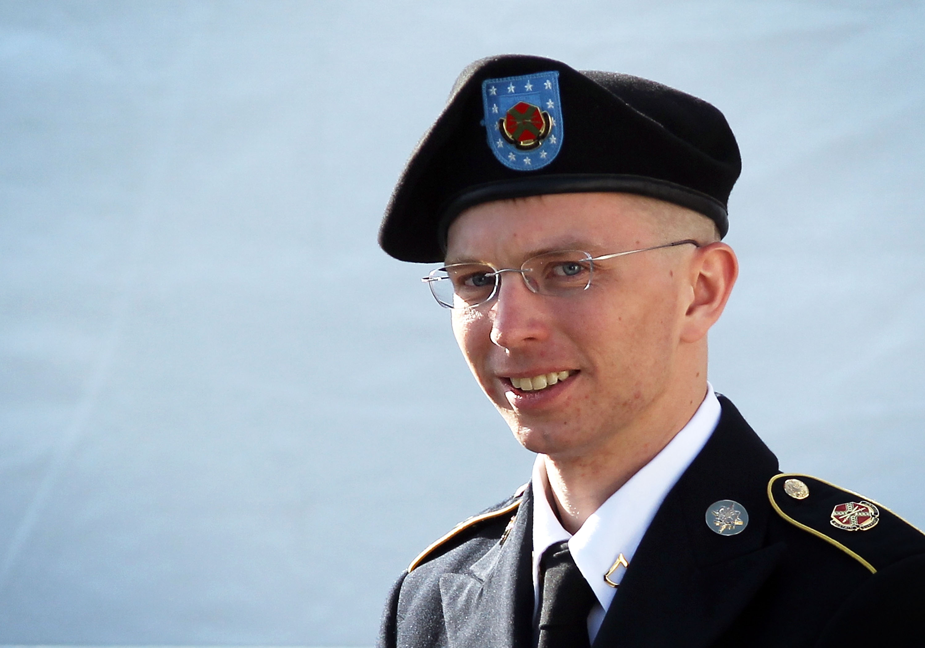 FORT MEADE, MD - JUNE 06: U.S. Army Private Bradley Manning is escorted as he leaves a military court at the end of the first of a three-day motion hearing June 6, 2012 in Fort Meade, Maryland. Manning, an Army intelligence analyst who has been accused of passing thousands of diplomatic cables and intelligence reports to the whistleblowing website WikiLeaks and facing 22 charges including aiding the enemy, returned to the court room to ask for dismissal of 10 of the charges. (Photo by Alex Wong/Getty Images)