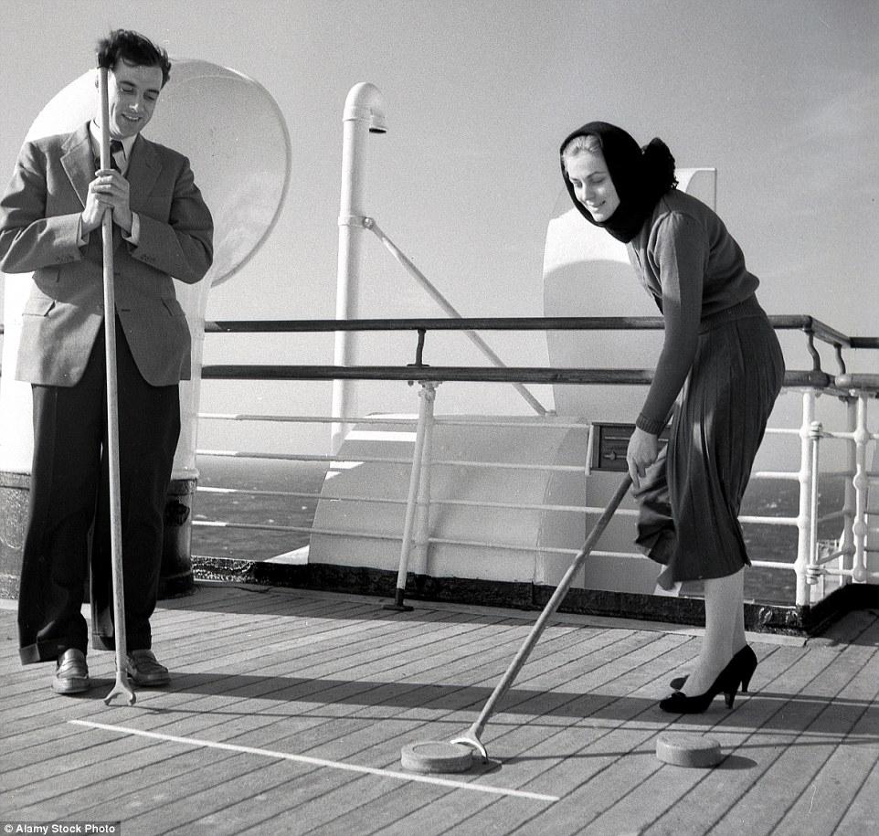 2C584E0700000578-3226659-Sporting_fun_Two_well_dressed_passengers_on_a_cruise_ship_enjoyi-m-14_1442337753153