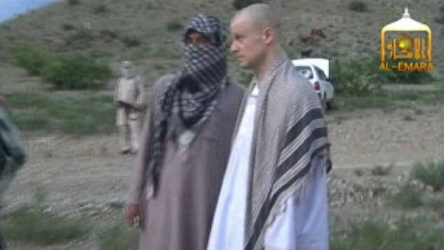 4564472700000578-4984786-Bergdahl_is_seen_above_being_released_in_2014_after_five_years_o-a-3_1508167727135