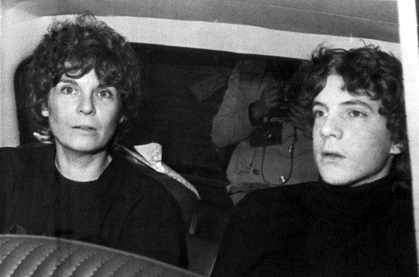 FILE - In this Dec. 15, 1973 file photo, former actress Gail Harris arrives in a police car with her son John Paul Getty III at police headquarters in Rome. Getty, the troubled grandson of a U.S. multibillionaire oil magnate who once lost an ear in a grisly kidnapping, has died at age 54. His son, actor Balthazar Getty, confirmed Tuesday Feb. 8, 2011 that his father died Saturday Feb. 5, 2011 surrounded by his family at his English mansion in Buckinghamshire, northwest of London. The cause of death was not disclosed. (AP Photo/Giuseppe Anastasi, File)