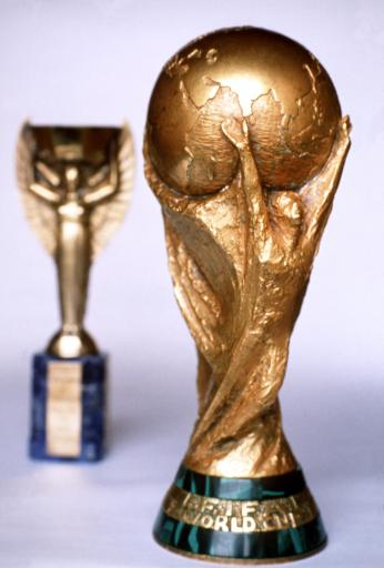 WORLD CUP TROPHY, WITH JULES RIMET TROPHY IN BACKGROUND