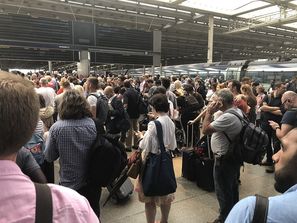17103682-7342803-Huge_queues_gathered_at_St_Pancras_station_this_evening_as_infor-a-97_1565394519931