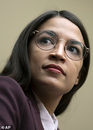 17130270-7344297-Alexandria_Ocasio_Cortez_is_leading_the_charge_to_demand_a_thoro-m-3_1565473084126