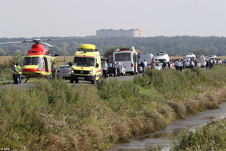 17303704-7361665-Ambulances_a_medical_helicopter_and_passing_vehicles_stop_to_hel-a-20_1565910306792