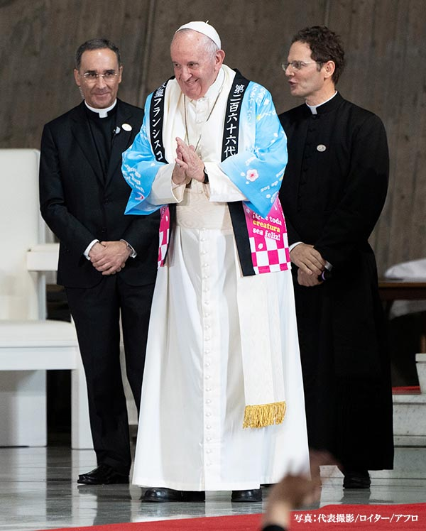 Pope Francis receives a traditional Japanese shirt designed by Catholic youths at St. Mary's Cathedral in Tokyo, Japan, November 25, 2019. Pierre Emmanuel Deletree/Pool via REUTERS