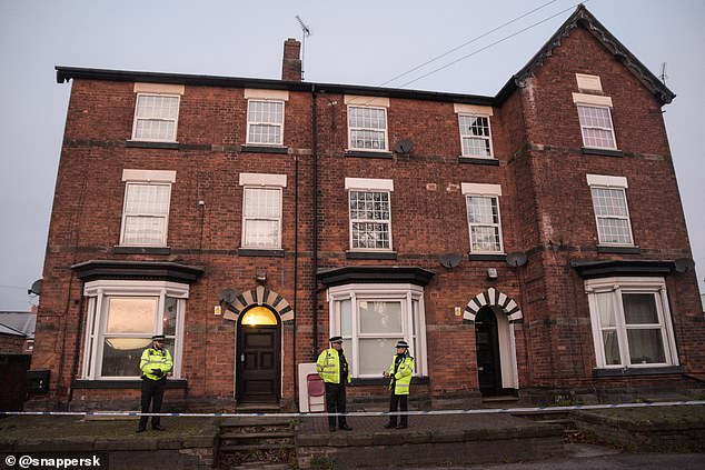 21644812-7742383-Staffordshire_police_officers_stand_guard_at_a_property_in_Staff-a-78_1575152778625
