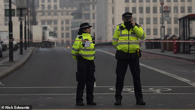 21645476-7742383-Police_officers_are_still_on_London_Bridge_as_Scotland_Yard_reve-a-71_1575152768990