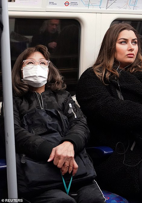 25281298-8055813-A_woman_wearing_a_protective_mask_travels_on_a_Jubilee_Line_tube-a-5_1582905695565