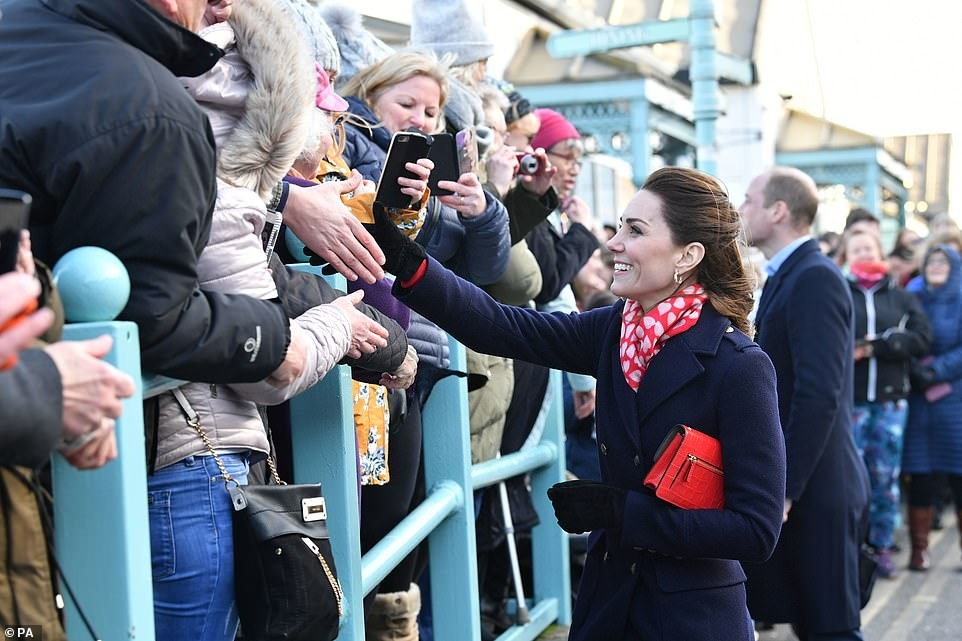 24294188-7964773-Shaking_hands_with_royalty_Kate_Middleton_reached_out_to_shake_s-a-7_1580831677937.jpg