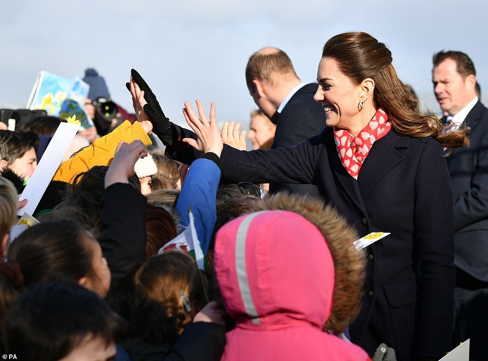 24294186-7964773-I_see_you_The_Duchess_of_Cambridge_took_time_to_high_five_severa-a-30_1580831677996.jpg