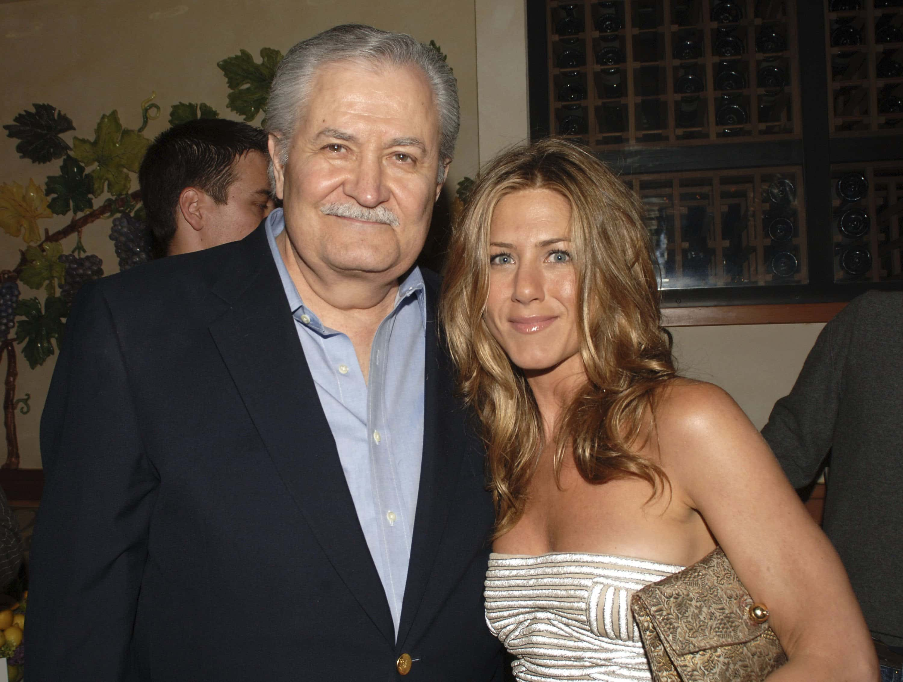 "WESTWOOD, CA - MAY 22: (L-R) Actor John Aniston and daughter actor Jennifer Aniston attend the after party following the world premiere of Universal Pictures ""The Break-Up"" at the Napa Grille on May 22, 2006 in Westwood, California. (Photo by Stephen Shugerman/Getty Images)"