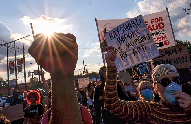 13ca19b8-ed9f-4aa9-9c58-d04fdda8e88b-AP_Protest_Shooting_Atlanta.1