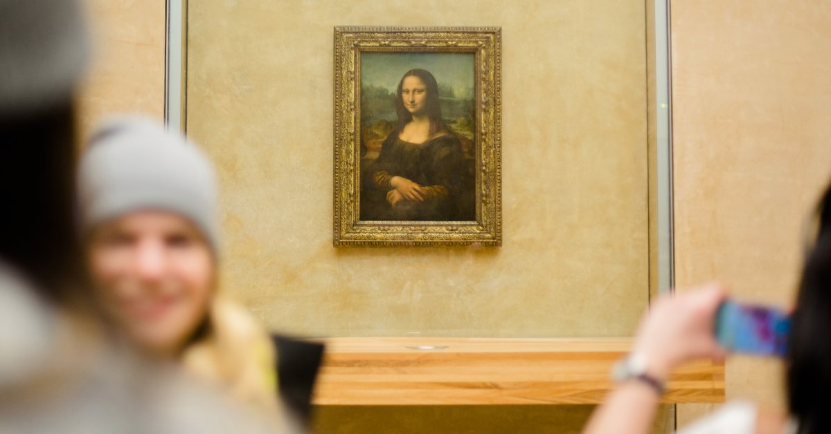 PARIS, FRANCE - FEBRUARY 28: Visitors take pictures of Leonardo da Vinci 'Mona Lisa' inside the Louvre museum on February 28, 2014 in Paris, France. The museum is housed in the Louvre Palace, one of the world's largest museums which opened 1793. (Photo by Christian Marquardt/Getty Images)